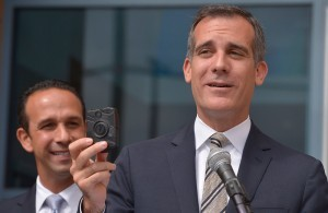 """City Councilman Mitchell Englander looks on as Mayor Eric Garcetti held a press conference in front of the LAPD Mission Division to talk about the first week trial use of officer body cameras. Mission Hills, CA 9/4/2015 (photo by John McCoy Daily News)"""
